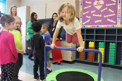 Students enjoy a mini trampoline