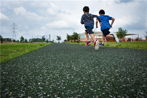 Porous pave walking tracks with two boys running
