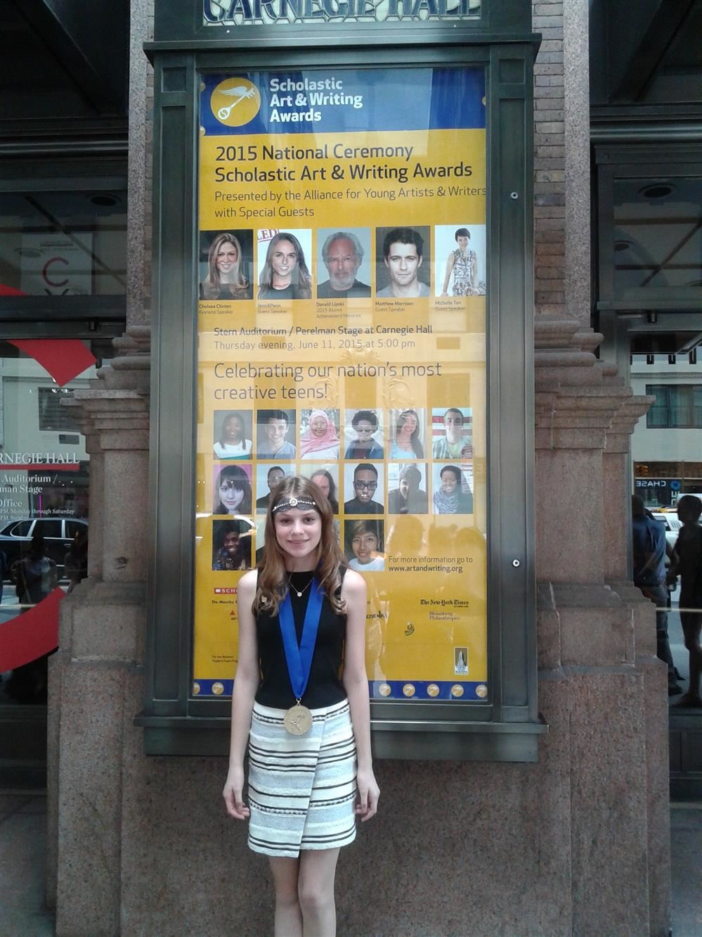 Student standing in front of Carnegie Hall